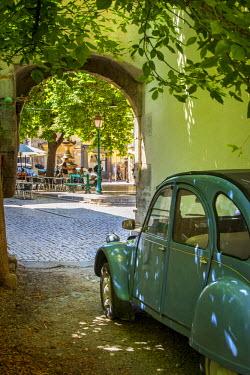 EU09BJN1103 Les Deux Chevaux, an old underpowered French car, parked facing the public square. Place Favier, Saint Remy de-Provence, France.