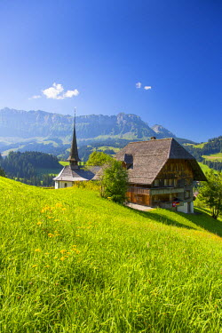 CH03737 Church and farmhouse in a village in the Emmental Valley, Berner Oberland, Switzerland