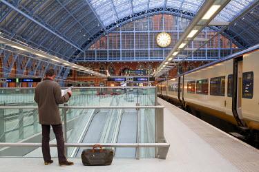 HMS0213936 United Kingdom, London, St Pancras International train station, Eurostar with a traveller reading his newspaper