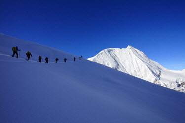 HMS1807682 Switzerland, Canton of Valais, Arolla, backcountry skiers ascending the Mont-Blanc de Cheilon (3870m)