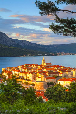 CR07226 Elevated view over picturesque Korcula Town illuminated at sunset, Korcula, Dalmatia, Croatia