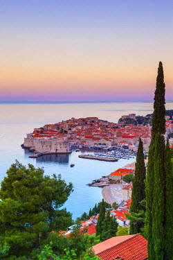 CR07195 Elevated view over Stari Grad (Old Town) illuminated at sunrise, Dubrovnik, Dalmatia, Croatia
