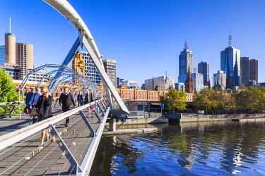 AS02300 Australia, Victoria, VIC, Melbourne, Yarra River footbridge and skyline, morning