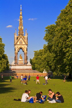 HMS0353861 United Kingdom, London, Kensington Gardens, picnic and football in front of Prince Albert Memorial (1872) by architect Sir George Gilbert Scott in honour of the spouse of Queen Victoria