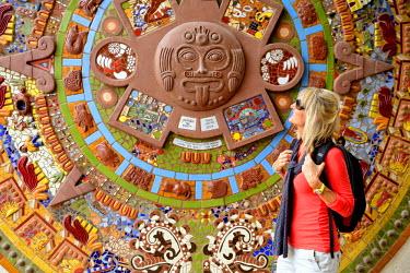 MEX1451AW Blonde woman in front of art mural, Todos Santos, Baja California Sur, Mexico MR