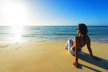 PHI1251 South East Asia, Philippines, The Visayas, Cebu, Bantayan Island, Sugar Beach, girl relaxing on the beach (MR)