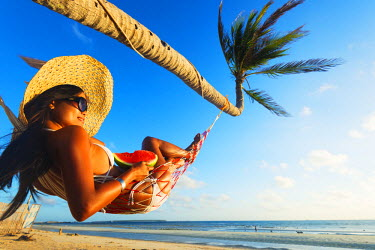 PHI1258 South East Asia, Philippines, The Visayas, Cebu, Bantayan Island, Sugar Beach, girl relaxing on the beach (MR)