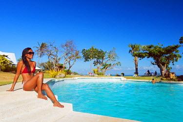 PHI1267 South East Asia, Philippines, The Visayas, Cebu, Bantayan Island, Paradise Beach, girl at Ogtong resort pool (MR)