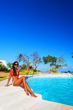 PHI1268 South East Asia, Philippines, The Visayas, Cebu, Bantayan Island, Paradise Beach, girl at Ogtong resort pool (MR)