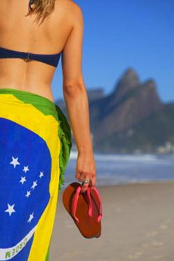 BRA2386AW Woman on Ipanema beach, Rio de Janeiro, Brazil (MR)