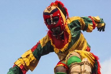 AF46ALA0288 Africa, West Africa, Togo, Atakpame. Close-up of performer stilt-walking.