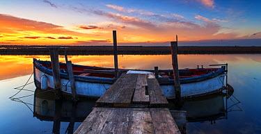 FVG009324 Sunset and pier on salt lake in Ravenna, Emilia Romagna, Italy