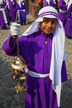 SA10CCE0009 Antigua, Guatemala. Young Boy with Incense Burner in Religious Procession during Holy Week, La Semana Santa.