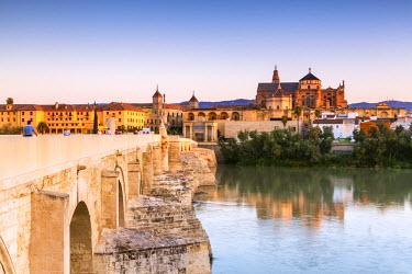 SPA5865AW Spain, Andalusia, Cordoba. Roman bridge and Cathedral at sunrise