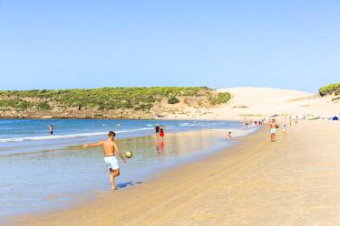 SPA5947AW Spain, Andalusia, Cadiz province, Costa de la Luz, Bolonia. Boys playing soccer on the beach
