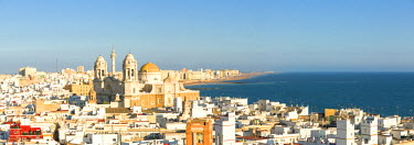 SPA5948AW Spain, Andalusia, Cadiz province, Cadiz. High angle view of the city at sunset