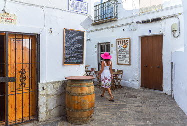 SPA5950AW Spain, Andalusia, Cadiz province, Tarifa. Woman walking in a street of the old town (MR)