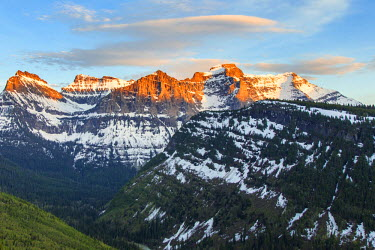 US27CHA3236 Mount Oberlin and Cannon catch days last light in spring at Glacier National Park, Montana, USA.