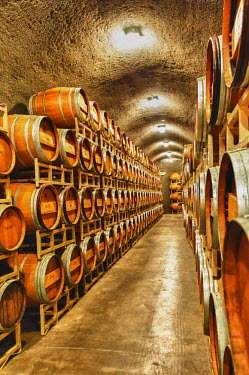 US48RDU1486 USA, Washington, Yakima Valley. Barrel cave in a winery from the Red Mountain AVA in Eastern Washington.