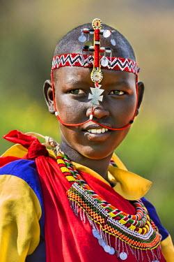 KEN8947 Kenya, Samburu County, Bawa. A Samburu schoolgirl from Ler Primary School dresses in typical tribal finery while competing in a schools� cultural display.