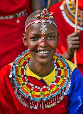 KEN8949 Kenya, Samburu County, Bawa. A Samburu schoolgirl from Ler Primary School dresses in typical tribal finery while competing in a schools cultural display.