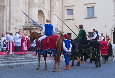 ITA3276AW Jousters being presented to Archbishop of Ascoli Piceno at procession of medieval festival of La Quintana outside Duomo (Cathedral), Ascoli Piceno, Le Marche, Italy