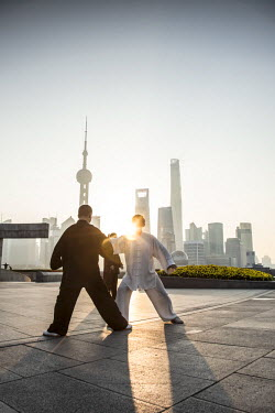 CN03499 Tai Chi on The Bund (with Pudong skyline behind), Shanghai, China
