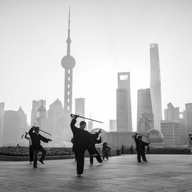 CN03506 Tai Chi on The Bund (with Pudong skyline behind), Shanghai, China