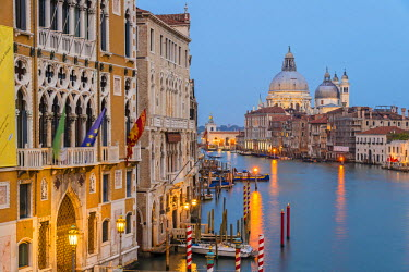 ITA3442AW Grand Canal at dusk with Palazzo Cavalli Franchetti at left and Santa Maria della Salute church in the distance, Venice, Veneto, Italy