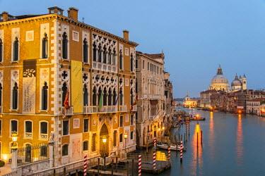 ITA3444AW Grand Canal at dusk with Palazzo Cavalli Franchetti at left and Santa Maria della Salute church in the distance, Venice, Veneto, Italy