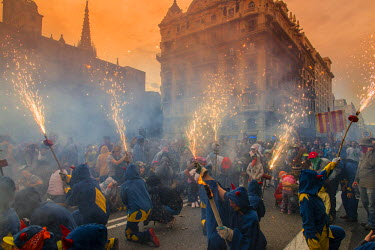 SPA6256AW Traditional correfocs or fire-runs performing at La Merce festival by using fireworks and effigies of the devil, Barcelona, Catalonia, Spain