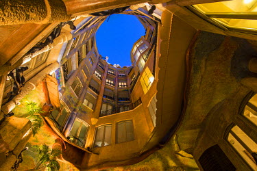 SPA6278AW Bottom view of the inner courtyard of Casa Mila or La Pedrera at dusk, Barcelona, Catalonia, Spain