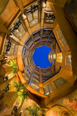 SPA6279AW Bottom view of the inner courtyard of Casa Mila or La Pedrera at dusk, Barcelona, Catalonia, Spain
