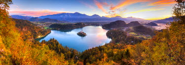 SV02141 Elevated view over Lake Bled & the Julian Alps illuminated at Sunrise, Lake Bled, Bled, Upper Carniola, Julian Alps, Slovenia