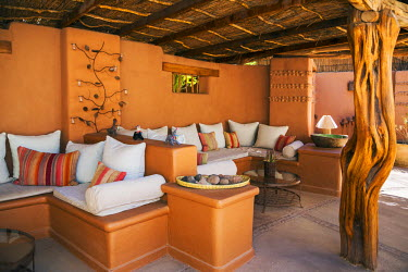 CHI8953 Chile, San Pedro de Atacama, Antofagasta Region, El Loa Province. An attractive sitting alcove in Awasi Atacama, one of several boutique tourist hotels situated in San Pedro de Atacama.