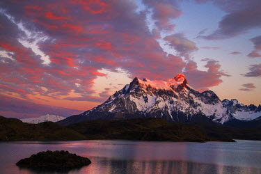 CHI8971 Chile, Torres del Paine, Magallanes Province. Sunrise over Cerro Paine Grande with Lake Pehoe in the foreground. One of the principal attractions of the Torres del Paine National Park is the magnifice...