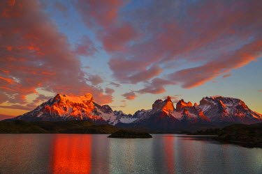 CHI8972 Chile, Torres del Paine, Magallanes Province. Sunrise over Torres del Paine with Lake Pehoe in the foreground. One of the principal attractions of the National Park is the magnificent Paine massif.