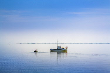 GER8295AW Boat in clam sea, Hallig Langeness, Northern Frisia, Schleswig-Holstein, Germany