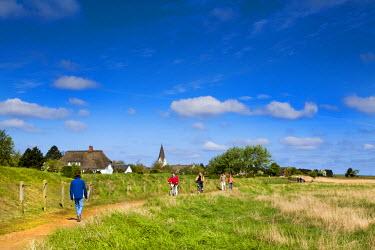 GER8274AW Walker in Nebel village, Amrum Island, Northern Frisia, Schleswig-Holstein, Germany