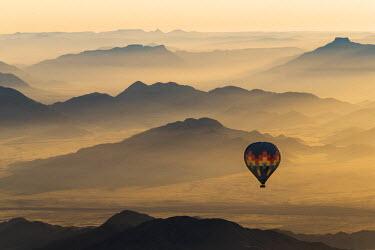 NAM6137AW Africa, Namibia, Namib Desert, Sossusvlei. Hot air balloon floating over the Sossusvlei.