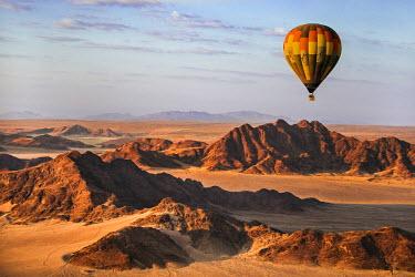 NAM6147AW Africa, Namibia, Namib Desert, Sossusvlei. Hot air balloon floating over the Sossusvlei.