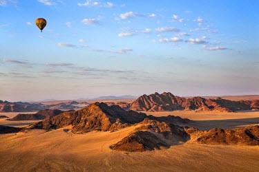 NAM6149AW Africa, Namibia, Namib Desert, Sossusvlei. Hot air balloon floating over the Sossusvlei.