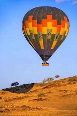 NAM6156AW Africa, Namibia, Namib Desert, Sossusvlei. Hot air balloon floating over the Sossusvlei.