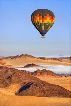 NAM6163AW Africa, Namibia, Namib Desert, Sossusvlei. Hot air balloon floating over the Sossusvlei.