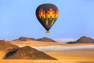 NAM6167AW Africa, Namibia, Namib Desert, Sossusvlei. Hot air balloon floating over the Sossusvlei.