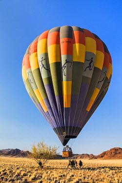 NAM6178AW Africa, Namibia, Namib Desert, Sossusvlei. Hot air balloon setting off over the Sossusvlei.