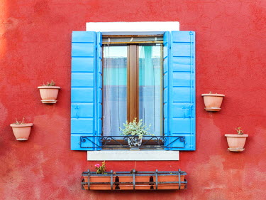 ITA3526AW Italy, Veneto, Venice, Burano. Typical window on a colorful house