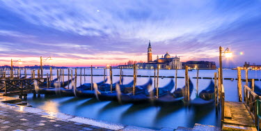 ITA3533AW Italy, Veneto, Venice. Row of gondolas moored at sunrise on Riva degli Schiavoni