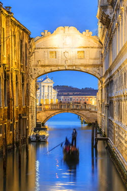 ITA3482AW Italy, Veneto, Venice. Bridge of sighs illuminated at dusk with gondolas