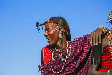 KEN9118AW Africa, Kenya, Narok County, Masai Mara. Maasai Man dressed in traditional attire.